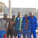 they get things done, construction workers in front of the Caltex site, Outapi